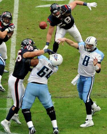 Tennessee Titans quarterback Matt Hasselbeck (8) throws a pass as  Leroy Harris (64) blocks  Houston Texans' Brian Cushing (56) in the first quarter of an NFL football game on Sunday, Jan. 1, 2012, in Houston. Photo: Dave Einsel, Associated Press