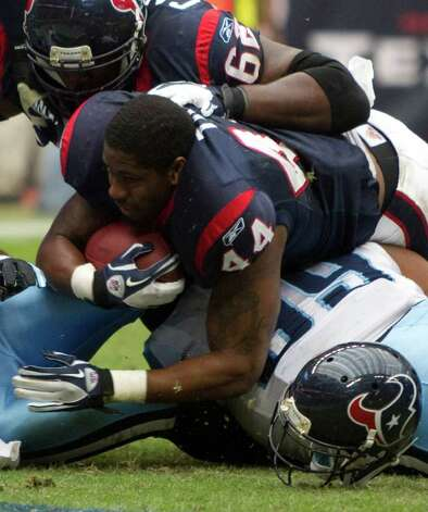 Houston Texans running back Ben Tate (44) scores on a four-yard touchdown run during the first quarter of an NFL football game against the Tennessee Titans at Reliant Stadium on Sunday, Jan. 1, 2012, in Houston. Photo: Brett Coomer, Houston Chronicle