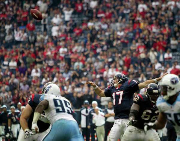 Houston Texans quarterback Jake Delhomme (17) reaches in vain for a high snap on a failed two-point conversion during the fourth quarter of an NFL football game against the Tennessee Titans, Sunday, Jan. 1, 2012, in Houston. The Titans defeated the Texans 23-22. Photo: Brett Coomer, Brett Coomer, Houston Chronicle / © 2012  Houston Chronicle