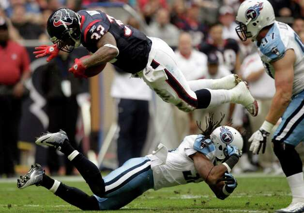 Houston Texans running back Derrick Ward (32) flips over Tennessee Titans defensive back Robert Johnson (32) during the first quarter of an NFL football game at Reliant Stadium on Sunday, Jan. 1, 2012, in Houston. Photo: Brett Coomer, Brett Coomer, Houston Chronicle / © 2012  Houston Chronicle