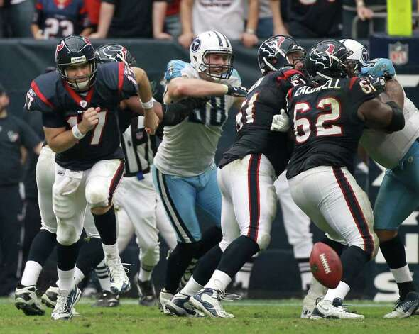 Houston Texans quarterback Jake Delhomme (17), left, chases a ball that was mis-snapped, stopping a two-point conversion and a chance to win the NFL football game, during the fourth quarter against the Tennessee Titans at Reliant Stadium on Sunday, Jan. 1, 2012, in Houston. Photo: Nick De La Torre, Houston Chronicle