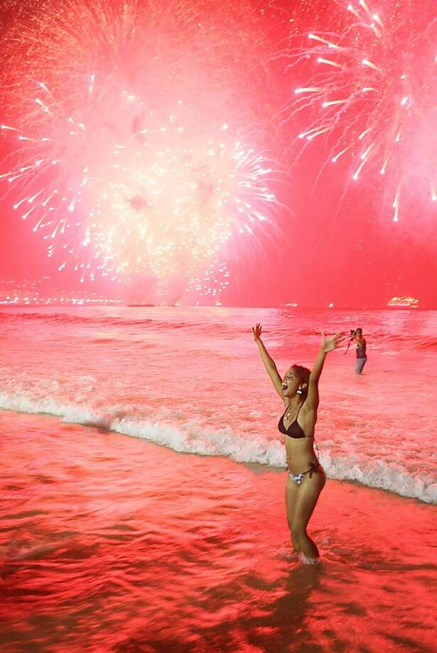 Red sky at night, beach-goers' delight:Now this is the way to ring in the new year. (Copacabana Beach in Rio de Janeiro on New Year's Eve.) Photo: Ari Versiani, AFP/Getty Images