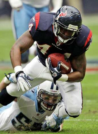 Houston Texans running back Ben Tate (44) is slowed down by Tennessee Titans middle linebacker Colin McCarthy (52) in the first quarter of an NFL football game on Sunday, Jan. 1, 2012, in Houston. Photo: David J. Phillip, Associated Press