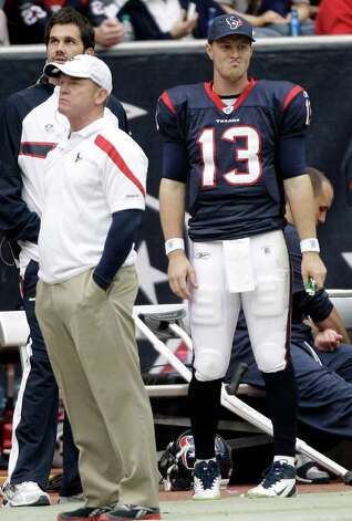 Houston Texans quarterback T.J. Yates (13) stands on the sidelines with injured quarterbacks Matt Leinart, back left, and  Matt Schaub, back right, in the second quarter of an NFL football game against the Tennessee Titans, Sunday, Jan. 1, 2012, in Houston. Photo: David J. Phillip, Associated Press
