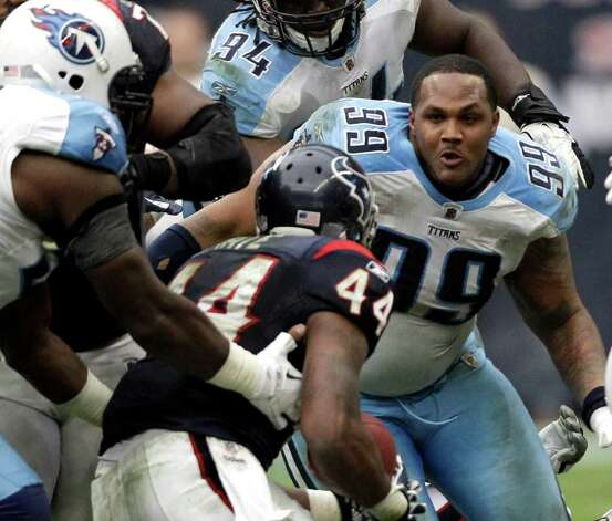 Tennessee Titans defensive tackle Jurrell Casey (99) moves in to hit Houston Texans running back Ben Tate (44) after losing his helmet in the fourth quarter of an NFL football game Sunday, Jan. 1, 2012, in Houston. The Titans defeated the Texans 23-22. Photo: David J. Phillip, Associated Press