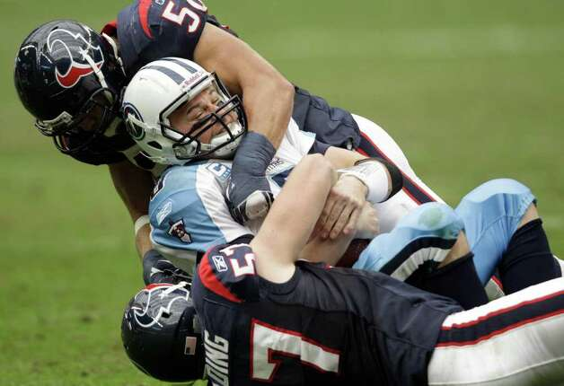 Tennessee Titans quarterback Matt Hasselbeck (8) is sacked by Houston Texans defensive end Jesse Nading (57) and  Brian Cushing (56) in the third quarter of an NFL football game on Sunday, Jan. 1, 2012, in Houston. The Titans won 23-22. Photo: David J. Phillip, Associated Press