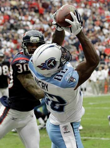 Tennessee Titans wide receiver Donnie Avery (82) makes the catch for a touchdown in front of Houston Texans cornerback Jason Allen (30) in the second quarter of an NFL football game on Sunday, Jan. 1, 2012, in Houston. Photo: David J. Phillip, Associated Press