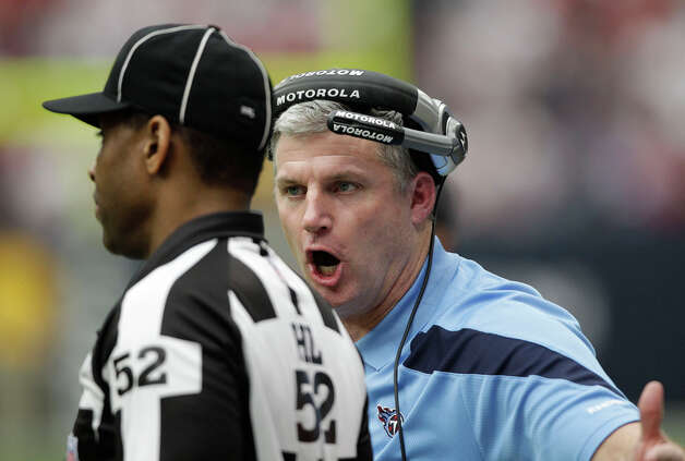 Tennessee Titans coach Mike Munchak, right, yells at head linesman Julian Mapp (52) in the first quarter of an NFL football game against the Houston Texans, Sunday, Jan. 1, 2012, in Houston. Photo: David J. Phillip, David J. Phillip, Associated Press / AP