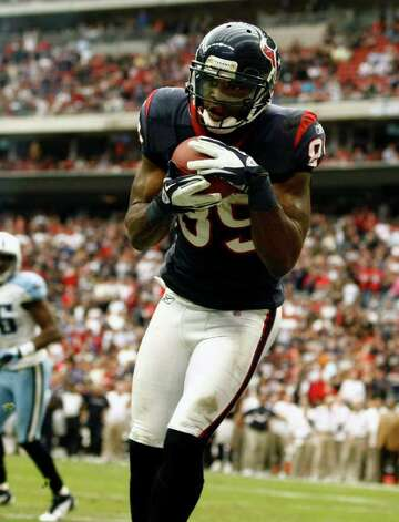Houston Texans wide receiver Bryant Johnson (89) scores a touchdown against Tennessee Titans during the second  half of an NFL football game on Sunday, Jan. 1, 2012, in Houston. Photo: AP Photo, Waco Tribune Herald, Jose Yau