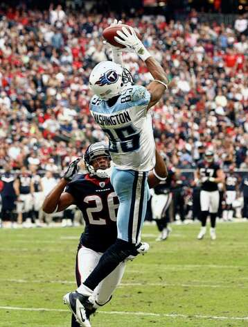 Tennessee Titans wide receiver Nate Washington (85) scores a touchdown against Houston Texans defensive back Brandon Harris (26) during the second  half of an NFL football game on Sunday, Jan. 1, 2012, in Houston. Photo: AP Photo, Waco Tribune Herald, Jose Yau