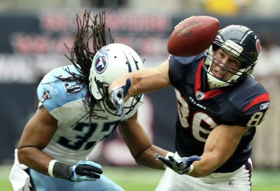 Houston Texans tight end James Casey (86) recovers the football while tackled by Tennessee Titans free safety Michael Griffin (33) during the first  half of an NFL football game on Sunday, Jan. 1, 2012, in Houston. Photo: AP Photo, Waco Tribune Herald, Jose Yau