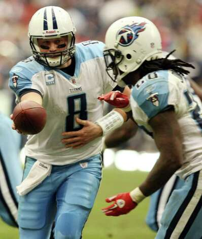 Tennessee Titans quarterback Matt Hasselbeck (8) passes the football to Titans running back Chris Johnson (28) during the second half of an NFL football game against the Houston Texans, Sunday, Jan. 1, 2012, in Houston. Photo: AP Photo, Waco Tribune Herald, Jose Yau