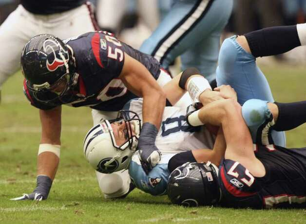 Tennessee Titans quarterback Matt Hasselbeck (8) is sacked by Houston Texans linebacker Bryan Braman (50) and defensive end Jesse Nading (57) during the second  half of an NFL football game on Sunday, Jan. 1, 2012, in Houston. Photo: AP Photo, Waco Tribune Herald, Jose Yau