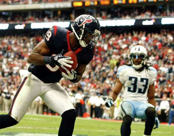 Houston Texans wide receiver Bryant Johnson (89) scores a touchdown against Tennessee Titans free safety Michael Griffin (33) during the second  half of an NFL football game Sunday, Jan. 01, 2012, in Houston. Photo: AP Photo, Waco Tribune Herald, Jose Yau