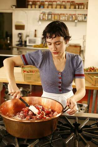 Rachel Saunders, founder of Blue Chair Fruit Company, mixing some strawberries with sugar before cooking, to make some jam in her kitchen facility in Alameda, Calif. on May 13, 2008. Photo by Craig Lee / The San Francisco Chronicle Photo: Photo By Craig Lee, SFC