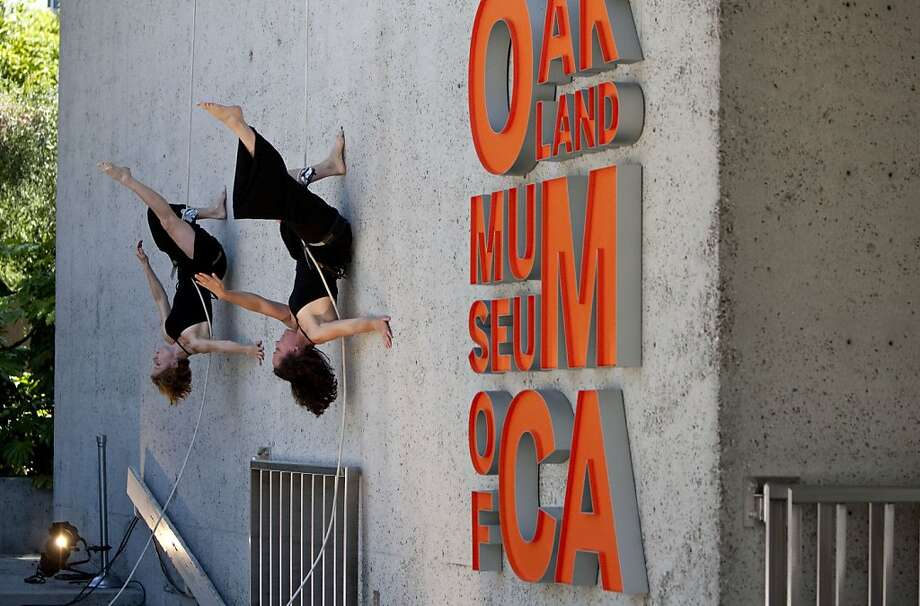 Anje Lockhart and Amelia Rudolph (right) from Project Bandaloop perform a vertical dance piece during the Oakland Museum of California reopening ceremonies in Oakland, Calif., on Saturday, May 01, 2010. Photo: Laura Morton, Special To The Chronicle