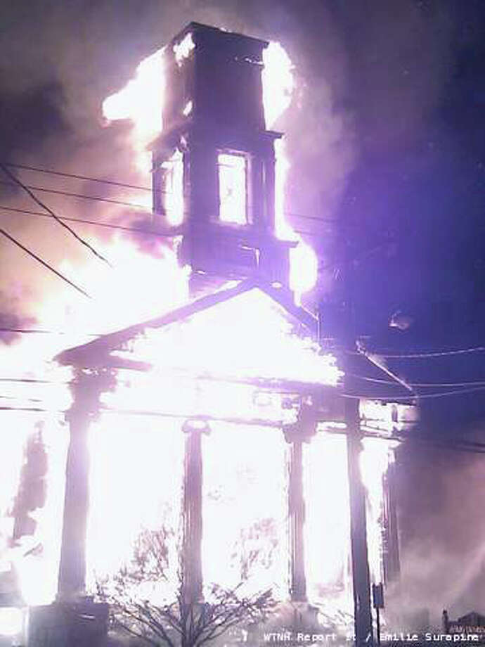 A fire has destroyed the Somers Congregational United Church of Christ. The fire broke out at the Main St. church at 12:37 a.m. Firefighters received a call about smoke in the center of town. That smoke was coming from the basement of the church, and quickly turned into a raging fire. Photo: WTNH Report-It