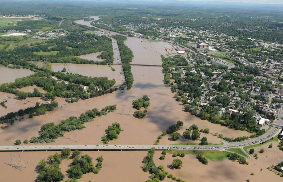 The Western Gateway Bridge from Schenectady to Scotia, pictured in the lower frame, was briefly closed as flood waters from Tropical Storm Irene pushed beyond the banks of the Mohawk River, Monday Aug. 29, 2011.  (Will Waldron / Times Union) Photo: Will Waldron