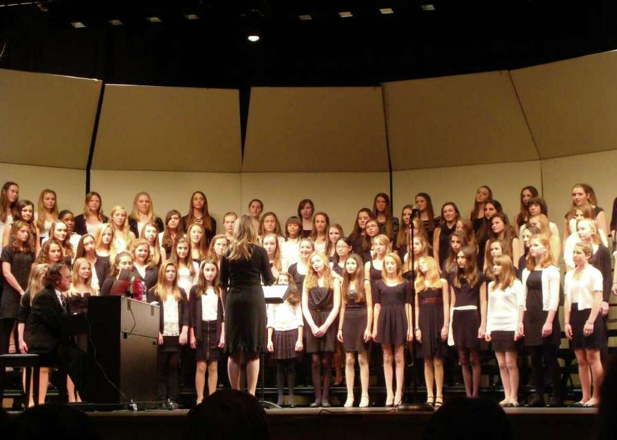 Saxe eighth grade girls sing for the audience.
