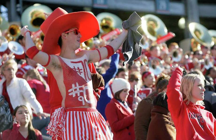 Michael Brown, of Sugar Land, cheers as the University of Houston players  the run onto the field before the Ticket City Bowl football game against Penn State Monday, Jan. 2, 2012, in the Cotton Bowl Stadium in Dallas. Photo: Nick De La Torre / © 2012  Houston Chronicle