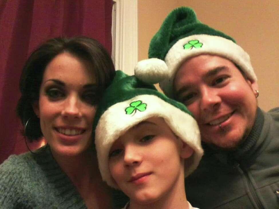 Warren Belcher, right, with girlfriend Sarah Babcock and stepson Kaleb.
