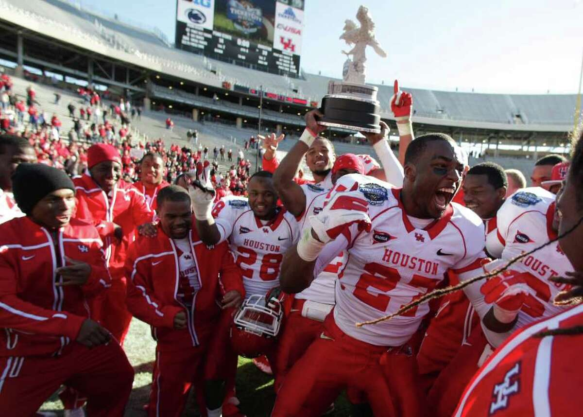 University of Houston running back Daniel Spencer (27) celebrates after he and his teammates beat Penn State 30-14 to win the Ticket City Bowl Monday, Jan. 2, 2012, in the Cotton Bowl Stadium in Dallas. ( Nick de la Torre / Houston Chronicle )