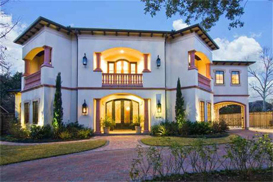 The property features a circular driveway and motor court as well as a two-car garage. Photo: Realtor.com