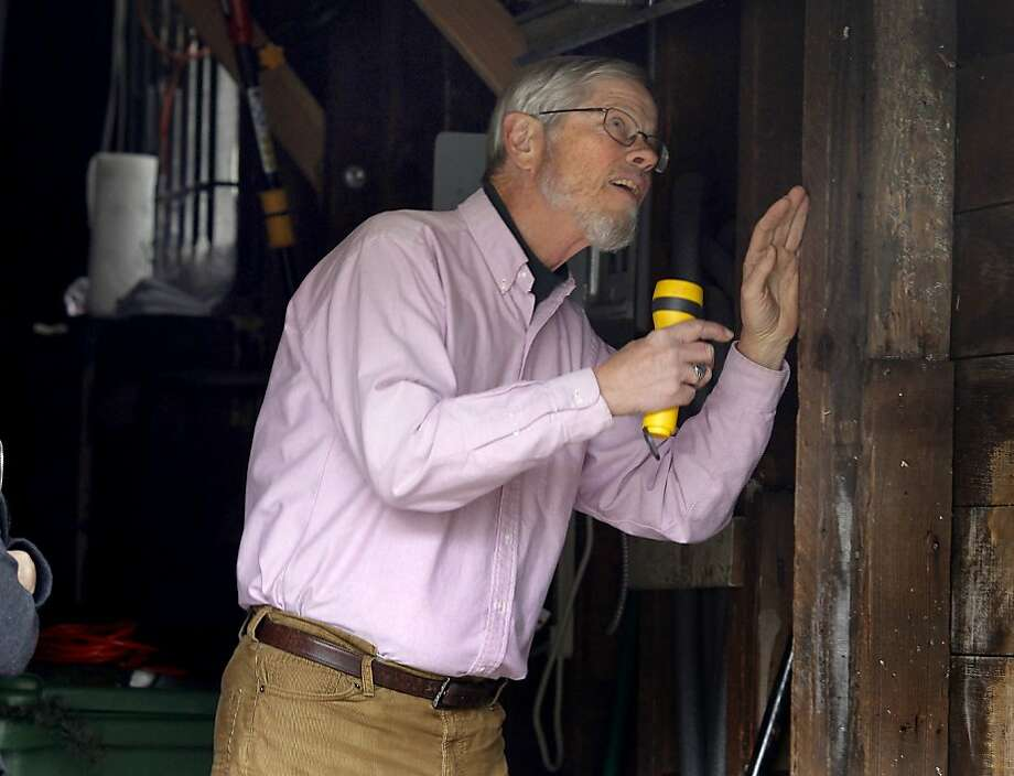 Larry Guillot inspects a garage space in an East Bay home. Larry Guillot runs a company called QuakePrepare which helps Bay Area homeowners and renters prepare for a major earthquake. Photo: Brant Ward, The Chronicle