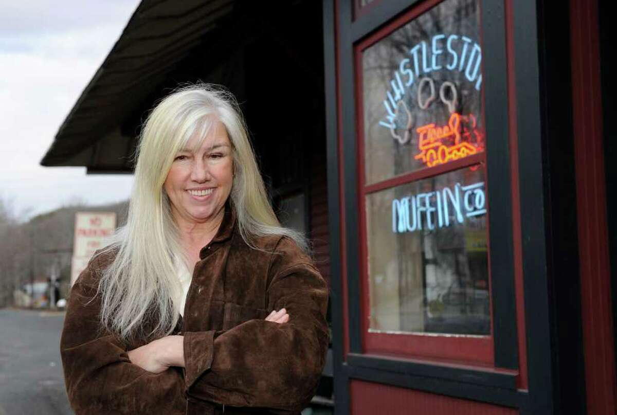 Lolly Turner of Bethel, owner of the Whistle Stop Bakery, LLC, at the Branchville Train Station in Ridgefield, poses outside of her shop. Photo taken Monday, Jan. 2, 2012.