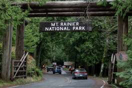 The west entrance to Mount Rainier National Park is shown, Sunday, Jan. 1, 2012 in Washington State. State Patrol Troopers were checking outgoing cars and park rangers were turning away visitors after a National Parks Service Ranger was shot and killed Sunday morning. (AP Photo/Ted S. Warren)