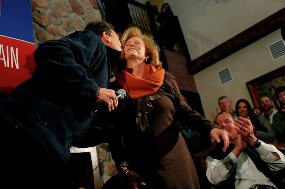 Republican presidential candidate Gov. Rick Perry kisses his wife, Anita Perry, after introducing her as he campaigns at Stoney Creek Inn in Sioux City, IA, on Monday, Jan. 2, 2012. Photo: LISA KRANTZ, SAN ANTONIO EXPRESS-NEWS / SAN ANTONIO EXPRESS-NEWS