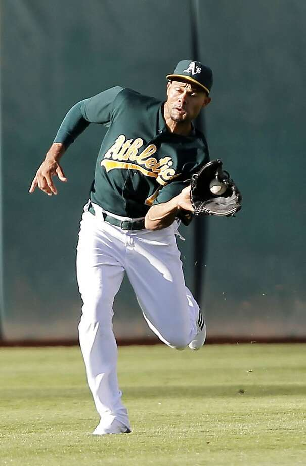 Athletic's Coco Crisp catches a fly ball hit by Arizona's Ryan Roberts in the second inning, as the Oakland Athletics take on the Arizona Diamondbacks at the O.co Coliseum in Oakland, Ca., on Saturday July 2, 2011. Photo: Michael Macor, The Chronicle