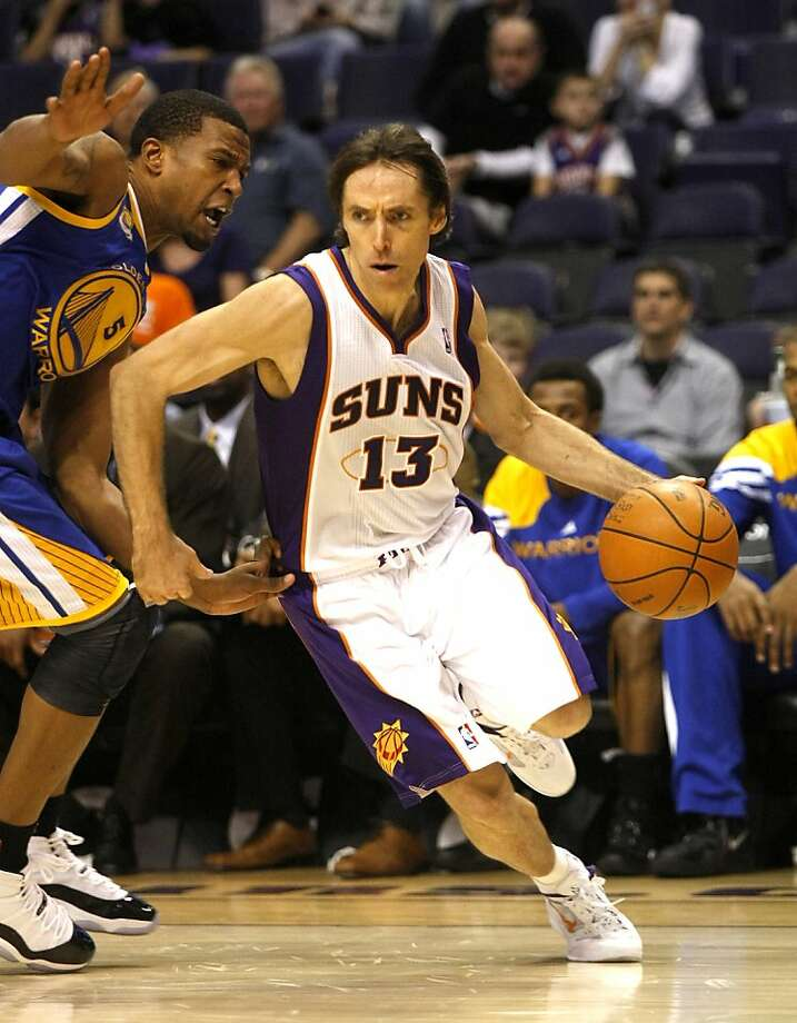 Phoenix Suns point guard Steve Nash, right, drives on Golden State Warriors small forward Dominic McGuire during the fourth quarter of an NBA basketball game on Monday, Jan. 2, 2012, in Phoenix.  (AP Photo/Rick Scuteri) Photo: Rick Scuteri, Associated Press