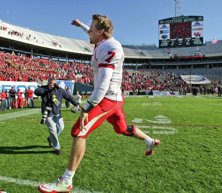 University of Houston quarterback Case Keenum (7) jumps for joy after  winning the Ticket City Bowl Monday, Jan. 2, 2012, in the Cotton Bowl Stadium in Dallas. The University of Houston won 30-14. Photo: Nick De La Torre, Houston Chronicle / © 2012  Houston Chronicle