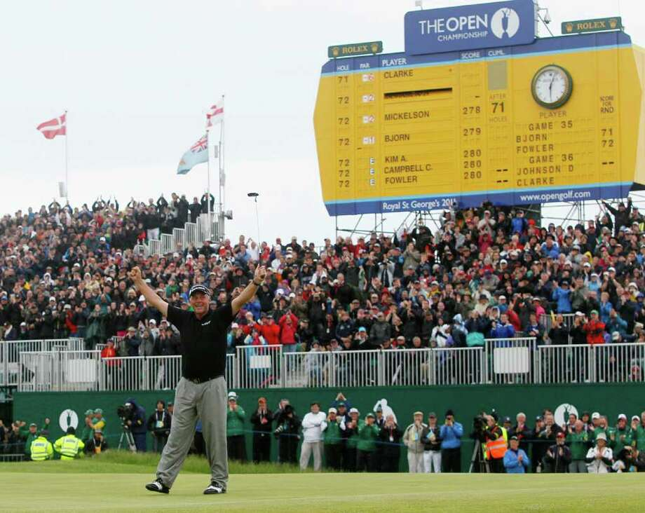 FILE - In this July 17, 2011, file photo, Northern Ireland's Darren Clarke raises his arms on the 18th green after winning the British Open Golf Championship at Royal St. George's golf course Sandwich, England. Clarke was having trouble on the hole in calculating the number of putts he could take without relinquishing the lead. Photo: AP