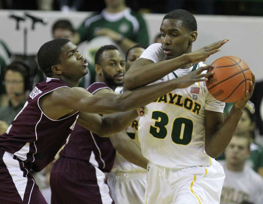 Texas A&M's Naji Hibbert,   left,  pressures Baylor's Quincy Miller (30) in the second half of Monday's game in Waco. (Duane A. Laverty/AP)