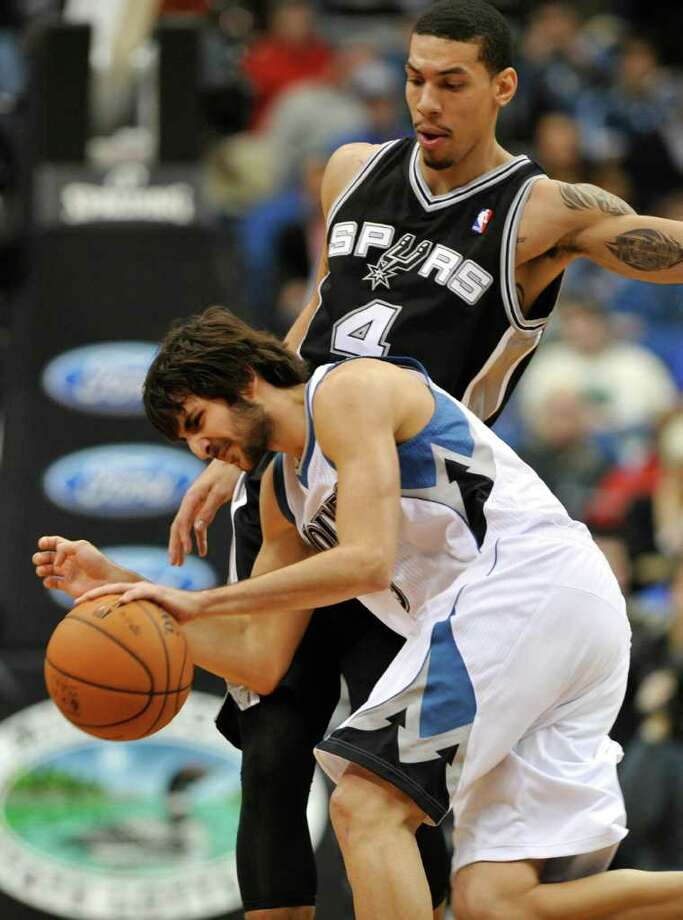Minnesota Timberwolves' Ricky Rubio, of Spain, drives around San Antonio Spurs' Daniel Green in the second half of an NBA basketball game, Monday, Jan. 2, 2012, in Minneapolis. The Timberwolves won 106-96. Photo: AP