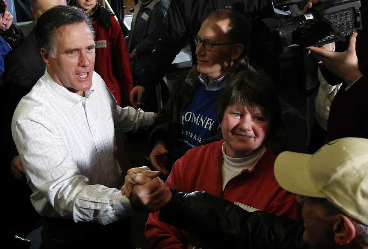 DAVENPORT, IA - JANUARY 02: Former Massachusetts governor and Republican presidential candidate Mitt Romney greets voters after speaking at a campaign event at the Mississippi Valley Fairgrounds January 2, 2012 in Davenport, Iowa. A poll published Saturday by the state's largest newspaper, The Des Moines Register, put Romney at the head of a large field of GOP candidates going into Tuesday's 'first in the nation' Iowa Caucuses. (Photo by Win McNamee/Getty Images)