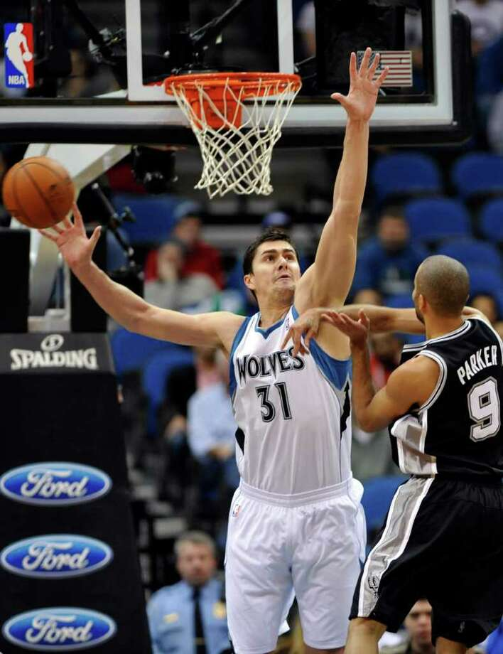 Minnesota Timberwolves' Darko Milicic, left, of Serbia, misses the block pass of San Antonio Spurs' Tony Parker in the first half of an NBA basketball game, Monday, Jan. 2, 2012, in Minneapolis. (AP Photo/Jim Mone) Photo: Associated Press