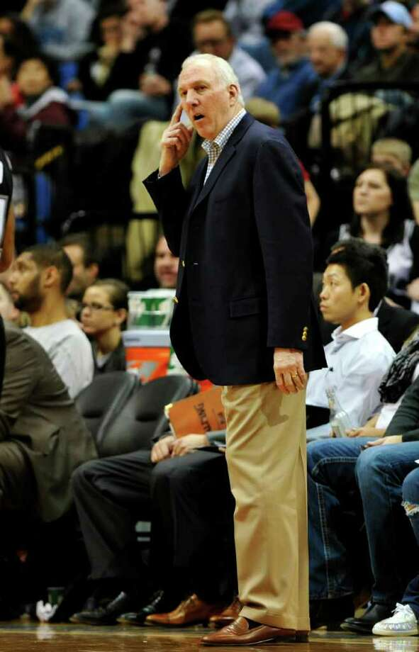 San Antonio Spurs head coach Gregg Popovich watches the action in the second half of an NBA basketball game against the Minnesota Timberwolves, Monday, Jan. 2, 2012, in Minneapolis. The Wolves won 106-96. (AP Photo/Jim Mone) Photo: Associated Press