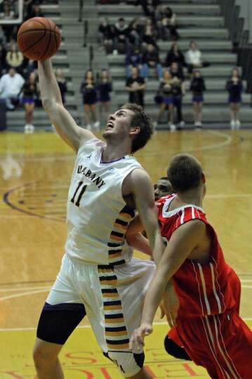 UAlbany's Luke Devlin battles Hartford's Nate Sikma, right, for the ball during the first half of UA