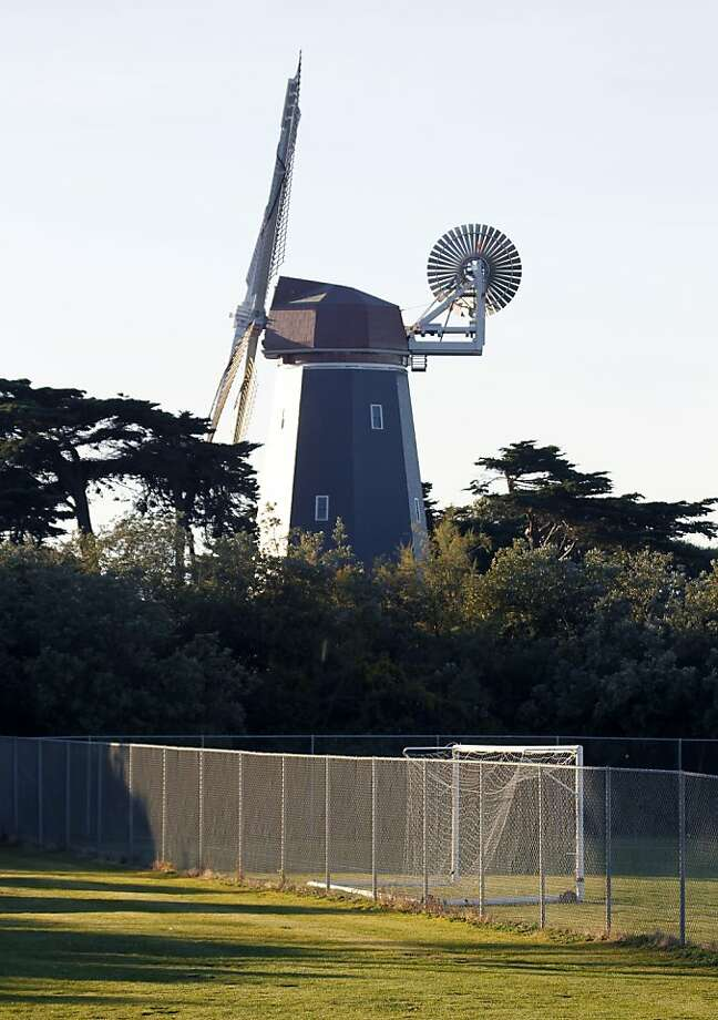 The Murphy windmill rises above the soccer field at Golden Gate Park in San Francisco, Calif. on Thursday, Dec. 22, 2011. The Recreation and Park Department is proposing a major renovation at the field which includes replacing the natural grass with synthetic turf. Photo: Paul Chinn, The Chronicle
