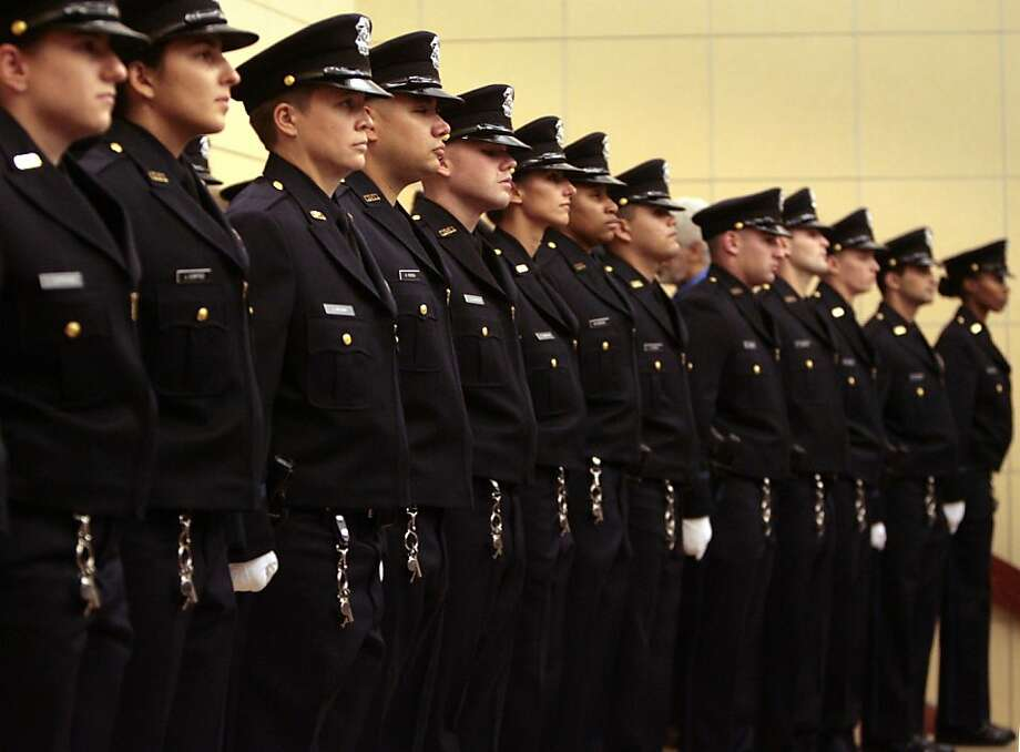 The graduates of the 165th Basic Academy stand at attention as the Oakland Police Department swears in 38 new officers at the Elihu Harris State Buildign in Oakland, Calif., on Friday, Nov. 14, 2008, realizing its long sought-after goal of fully staffing the force. Photo: Kim Komenich, The Chronicle