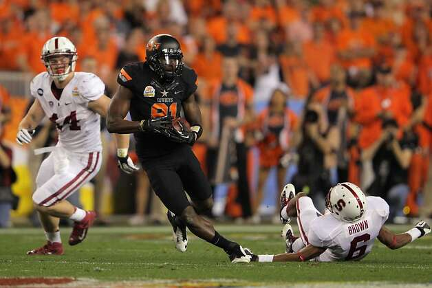 GLENDALE, AZ - JANUARY 02:  Justin Blackmon #81 of the Oklahoma State Cowboys catches a 67-yard touchdown reception in the second quarter against Chase Thomas #44 and Terrence Brown #6 of the Stanford Cardinal during the Tostitos Fiesta Bowl on January 2, 2012 at University of Phoenix Stadium in Glendale, Arizona.  (Photo by Doug Pensinger/Getty Images) Photo: Doug Pensinger, Getty Images