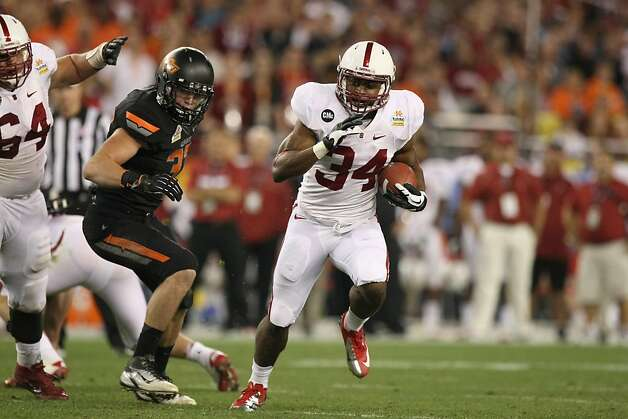 GLENDALE, AZ - JANUARY 02:  Jeremy Stewart #34 of the Stanford Cardinal runs for a 24-yard rushing touchdown in the second quarter against the Oklahoma State Cowboys during the Tostitos Fiesta Bowl on January 2, 2012 at University of Phoenix Stadium in Glendale, Arizona.  (Photo by Donald Miralle/Getty Images) Photo: Donald Miralle, Getty Images
