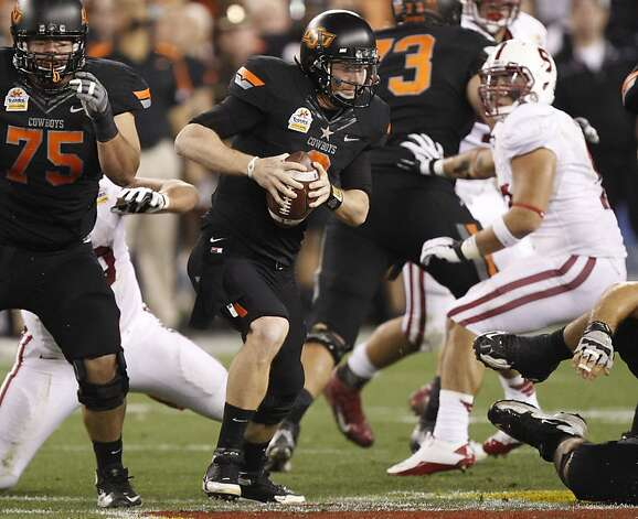 Oklahoma State quarterback Brandon Weeden (3) scrambles against  Stanford during the first half of the Fiesta Bowl NCAA college football game Monday, Jan. 2, 2012, in Glendale, Ariz. (AP Photo/Paul Connors) Photo: Paul Connors, Associated Press