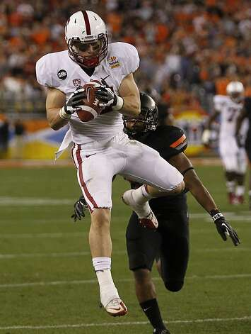 Stanford receiver Griff SWhalen comes down with a key first down pass against the Oklahoma State Cowboys in the second quarter of the Fiesta Bowl game in Glendale, Ariz. on Monday, Jan. 2, 2012. Photo: Paul Chinn, The Chronicle