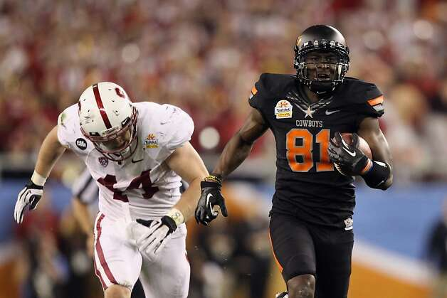 GLENDALE, AZ - JANUARY 02:  Justin Blackmon #81 of the Oklahoma State Cowboys catches a 67-yard touchdown reception in the second quarter against Chase Thomas #44 of the Stanford Cardina during the Tostitos Fiesta Bowl on January 2, 2012 at University of Phoenix Stadium in Glendale, Arizona.  (Photo by Christian Petersen/Getty Images) Photo: Christian Petersen, Getty Images