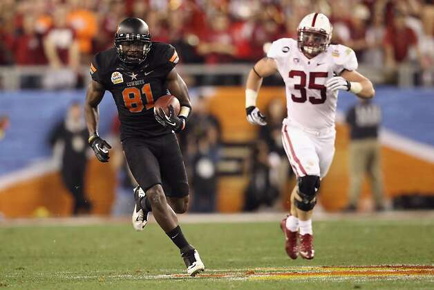 GLENDALE, AZ - JANUARY 02:  Justin Blackmon #81 of the Oklahoma State Cowboys catches a 67-yard touchdown reception in the second quarter against Jarek Lancaster #35 of the Stanford Cardinal during the Tostitos Fiesta Bowl on January 2, 2012 at University of Phoenix Stadium in Glendale, Arizona.  (Photo by Christian Petersen/Getty Images) Photo: Christian Petersen, Getty Images
