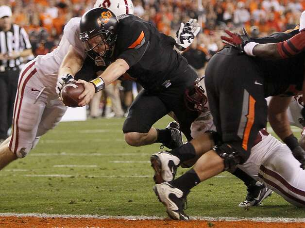 Oklahoma State quarterback Brandon Weeden lunges across the goal line for a touchdown against Stanford during the first half of the Fiesta Bowl NCAA college football game Monday, Jan. 2, 2012, in Glendale, Ariz. (AP Photo/Matt York) Photo: Matt York, Associated Press